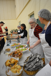 Food Service Worker student Mary Sears serves catered meal to guests