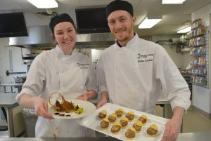 Kylie Piney and Braden Lawther during their practice round in Fleming's Kitchen Lab