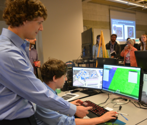 Sean McPherson (left) and Mackenzie Marsh demonstrate the 3D visualization of Peterborough Airport