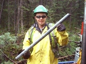 Dan on the job holding rock core