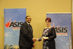 Fleming faculty member and ASIS Toronto Education Committee member Brine Hamilton (left) presents Crystal Dudgeon with the ASIS Friends and Family Scholarship