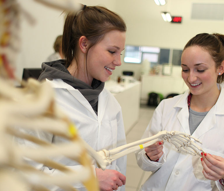 Pre-Health Sciences Pathway students working in a lab